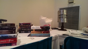Books and Helm at the party, piled into lots to be given away, along with some bonus Tor goodies.
