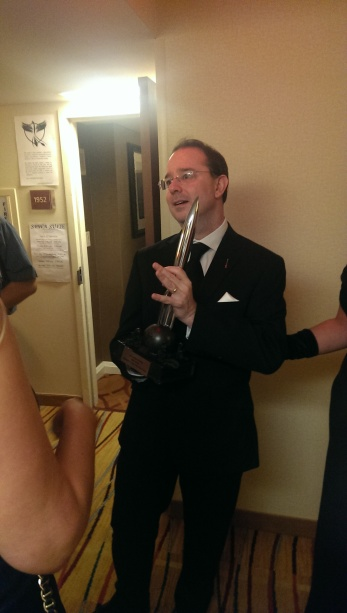 John Scalzi poses with his Hugo for best novel, about an hour after he won it. He seemed dazed.
